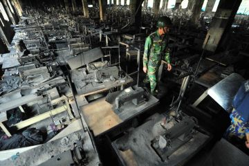Charred sowing machines after factory fire - Source: AFP
